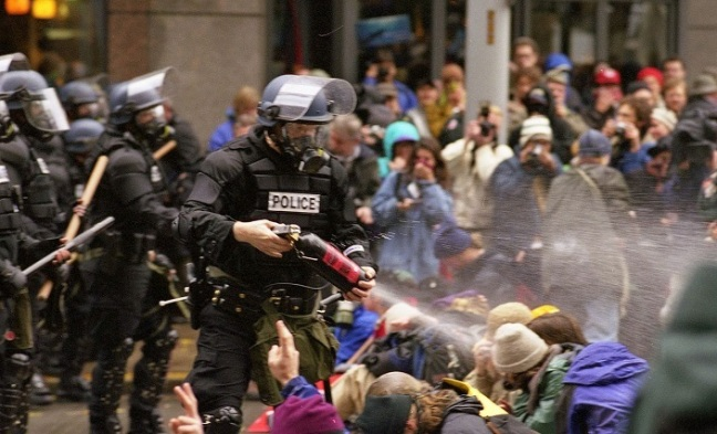Police using pepper spray to disband a peaceful protest